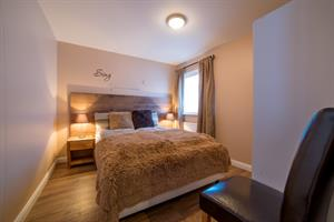 Bedroom with a double bed in the 6 person cottage