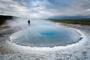 Visit the Geysir hot spring area in South Iceland.
