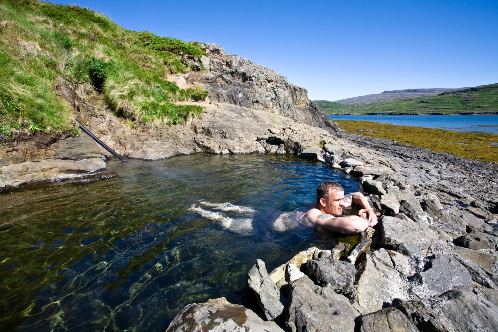 Natural hot spring pool in Vatnsfjrur Westfjords